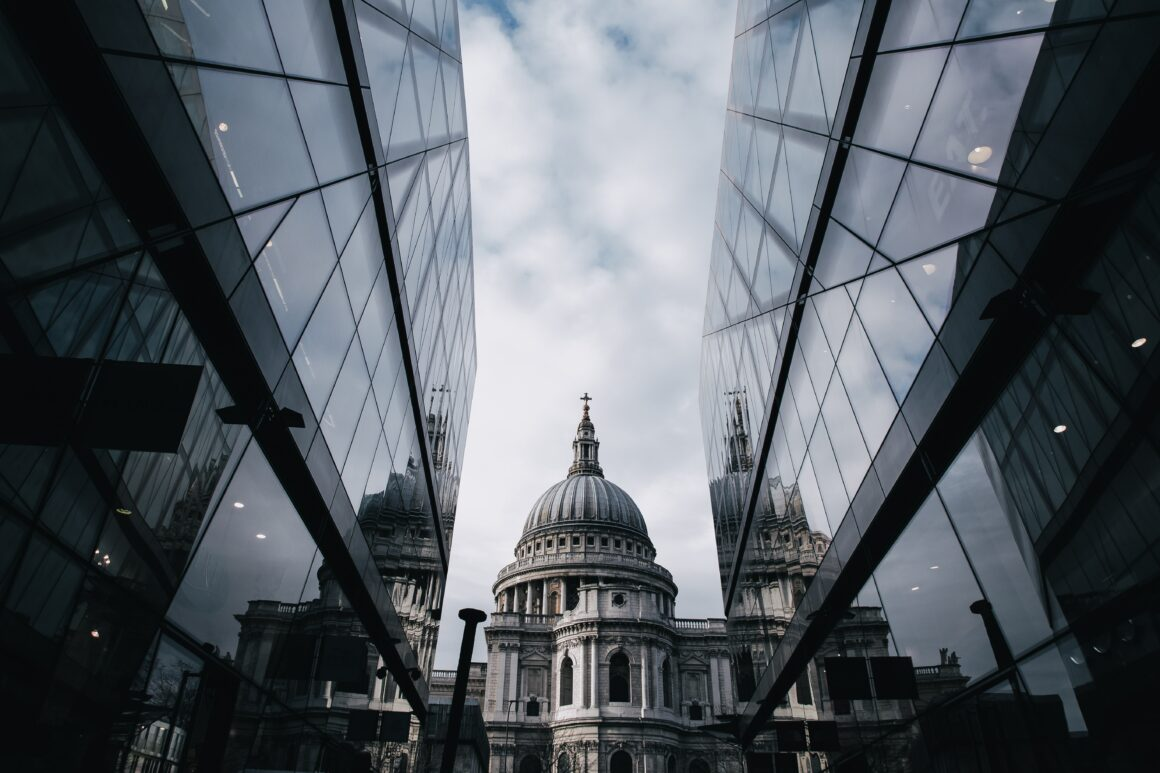 St Paul's cathedral surrounded by glass buildings